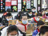 Elementary school students wearing face masks attend a class as they return to school after the start of the term was delayed due to the COVID-19 coronavirus outbreak, in Huaian in China's eastern Jiangsu province on April 7, 2020. (Photo by STR / AFP) / China OUT