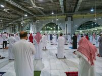 """Saudis and expats perform """"Al Fajr"""" prayers at the Grand Mosque in the holy city of Mecca, on October 18, 2020, for the first time after easing months-long COVID-19 restrictions.,Image: 564346374, License: Rights-managed, Restrictions: , Model Release: no"""