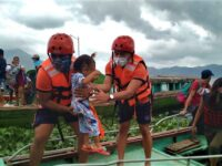 """A handout photo taken on October 31, 2020 from the facebook page of Philippine Coast Guard, shows personnels from the coast guard evacuating residents from the coastal villages of Buhi town, Camarines Sur province, south of Manila, to a safer place, ahead of Typhoon Goni's landfall.,Image: 566553830, License: Rights-managed, Restrictions: -----EDITORS NOTE --- RESTRICTED TO EDITORIAL USE - MANDATORY CREDIT """"AFP PHOTO / PHILIPPINE COAST GUARD"""" - NO MARKETING - NO ADVERTISING CAMPAIGNS - DISTRIBUTED AS A SERVICE TO CLIENTS  - NO ARCHIVE, Model Release: no"""